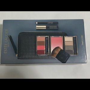 Brand new travel makeup kit. Unopened